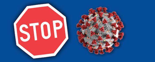 ett stopp-märke och covid 19 viruset
